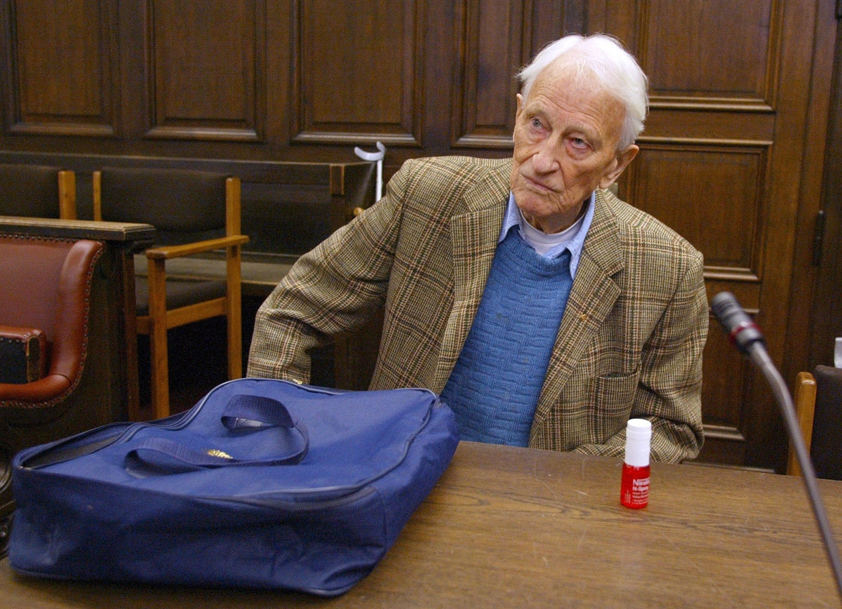 Friedrich Engel, a 93-year-old former Nazi SS officer, sits 12 June 2002 in a Hamburg courtroom before his trial. Engel is charged with ordering the murder of 59 Italian prisoners more than 50 years ago. Dubbed the Butcher of Genoa