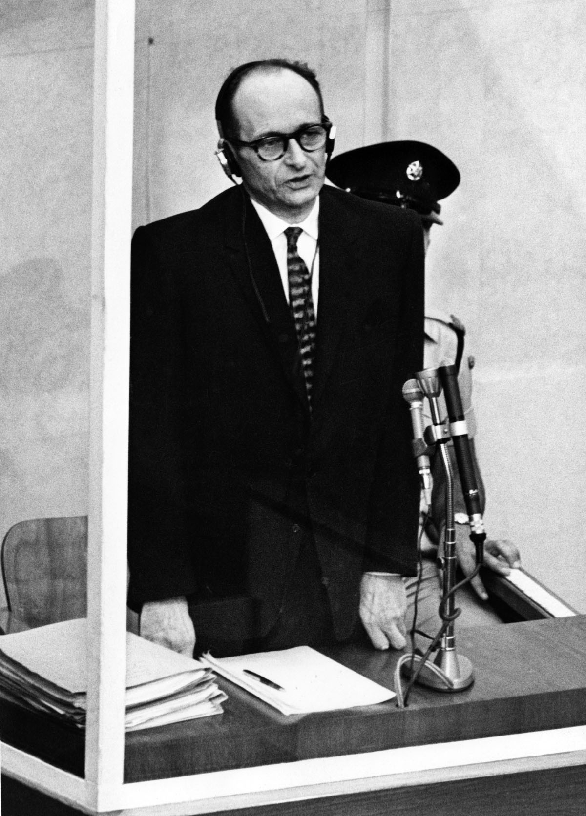 Nazi war criminal Adolf Eichmann testifies in his bullet-proof dock during the first day of his trial in front of an Israeli court, 11 April 1961, in Jerusalem. Former Nazi SS leader, and one of the main organizers of the extermination camps in Nazi-occup