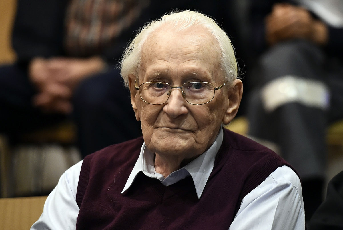 Convicted former SS officer Oskar Groening listens to the verdict of his trial on July 15, 2015 at court in Lueneburg, northern Germany. Oskar Groening, 94, sat impassively as judge Franz Kompisch said the defendant is found guilty of accessory to murder