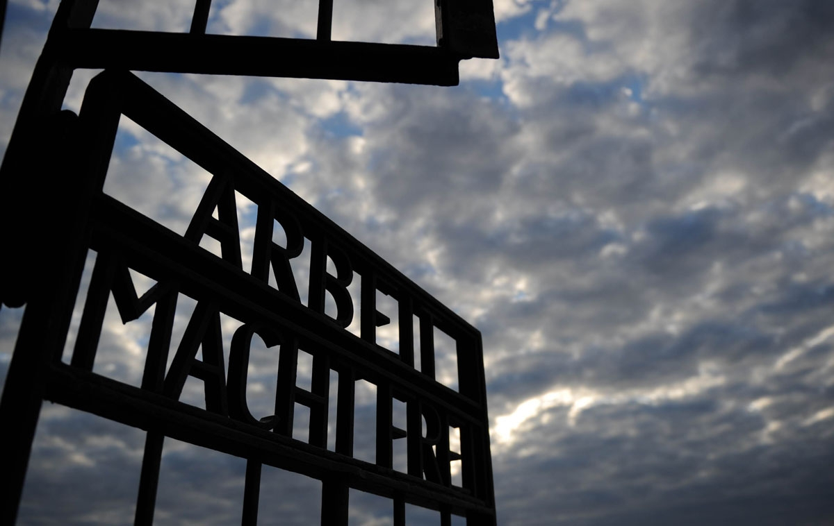 The writing Arbeit Macht Frei (Work Sets You Free) can be seen at the gate of Sachsenhausen concentration camp memorial on September 03, 2010 in Oranienburg, northeastern Germany. AFP PHOTO /