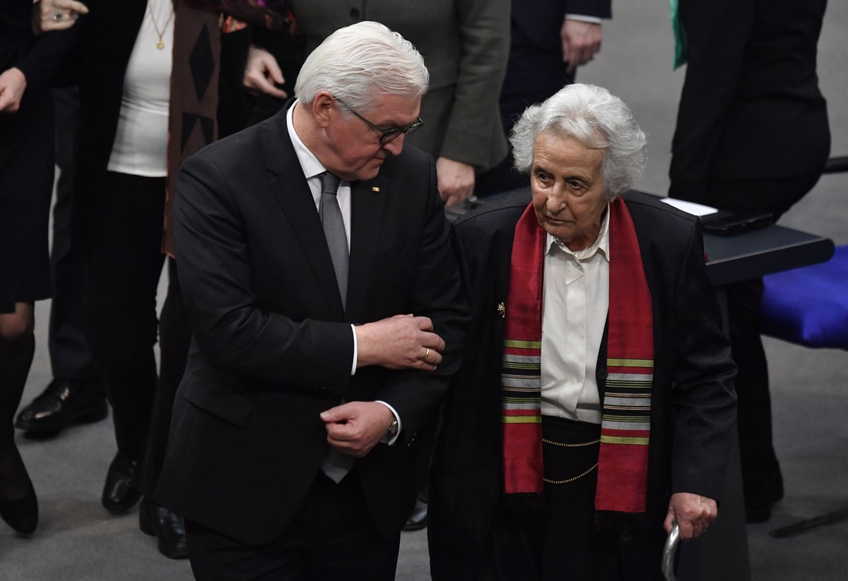 German President Frank-Walter Steinmeier and Holocaust survivor and cellist Anita Lasker-Wallfisch arrive for the annual ceremony in memory of Holocaust victims and survivors, on January 31, 2018, at the Bundestag (Germany's lower house of parliament), in