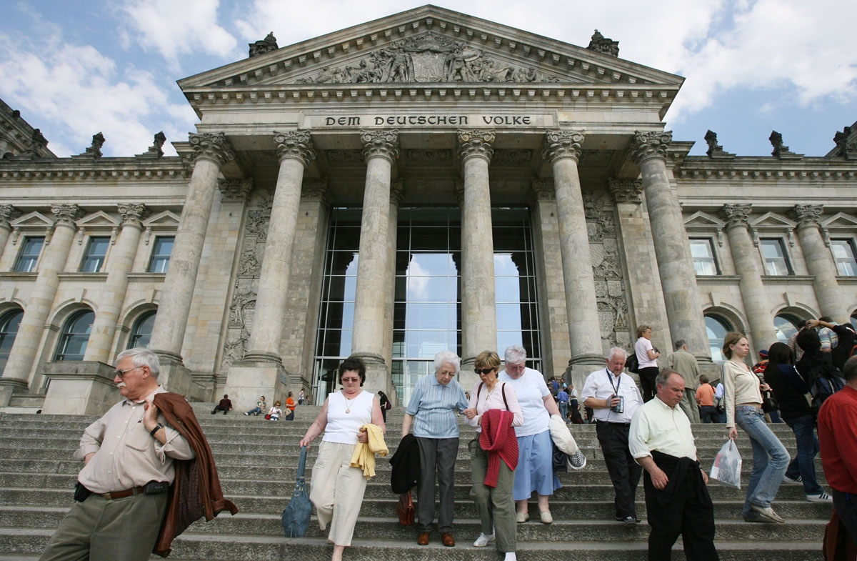 Elderly tourists leave Berlin's landmark Reichstag building, which houses the country's lower house of parliament 04 May 2006. Germany is expecting millions of visitors during the FIFA 2006 Football World Cup, which takes place in Germany from 09 June to