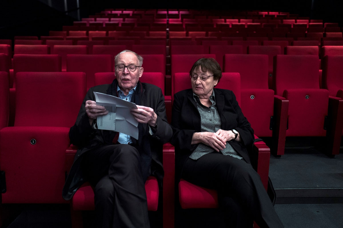 German married couple Erika and Ulrich Gregor pose at a movie theatre in Berlin on February 8, 2018. It's a love that was born in a cinema in 1950s Cold War Berlin and that's been nourished for over six decades by at least a movie a day together. It's tha