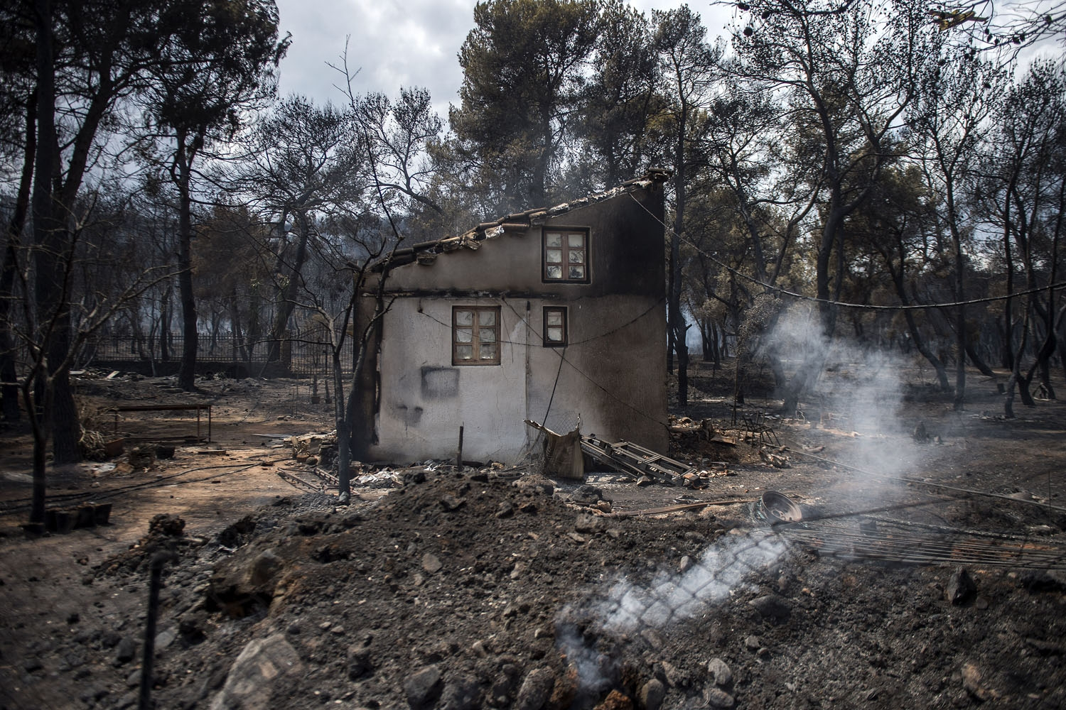 A photo shows a burned house following a wildfire at the village of Neos Voutzas, near Athens, on July 24, 2018.