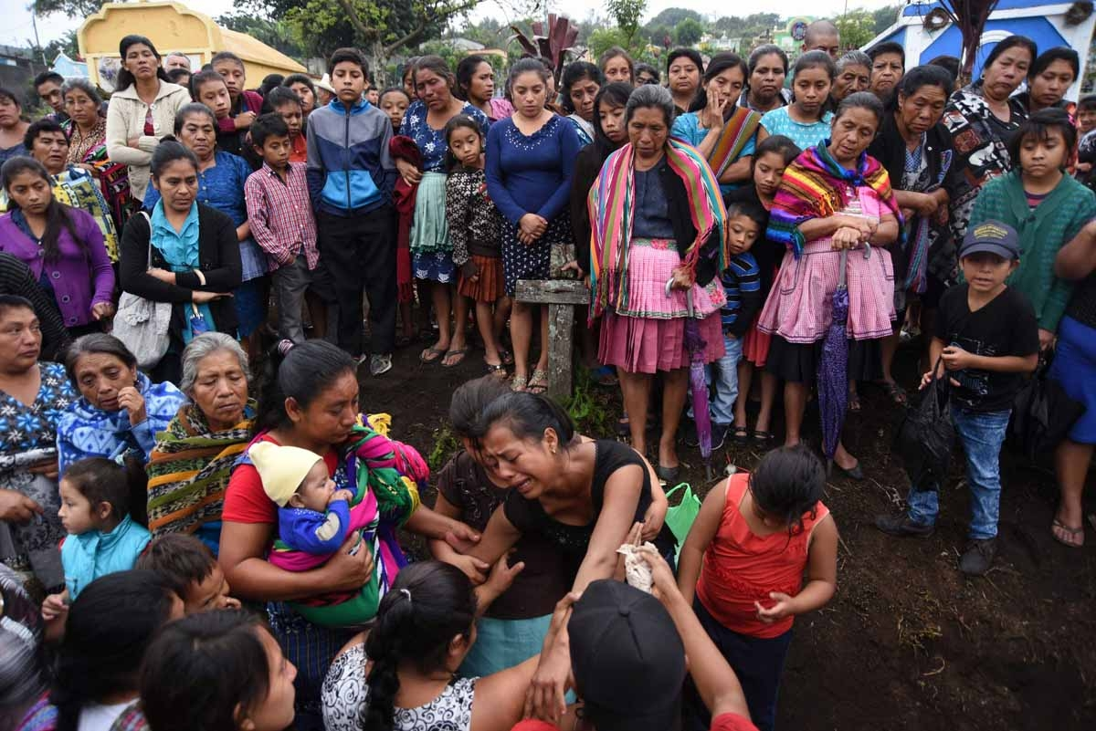 Relatives and residents attend a funeral of Erick Rivas, 20 year-old, who died following the eruption of the Fuego volcano, along the streets of Alotenango municipality, Sacatepequez, about 65 km southwest of Guatemala City, on June 6, 2018. Nearly 200 pe