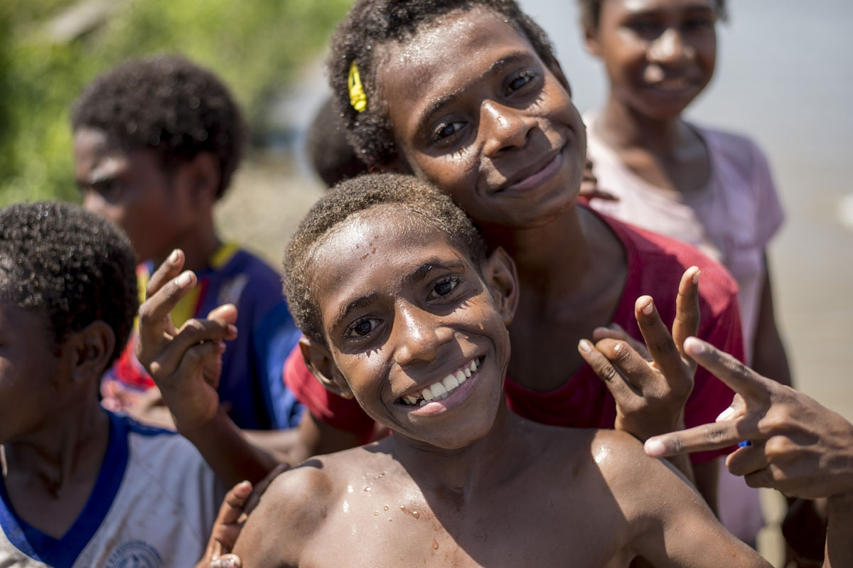 Papuan children pose in Agats, the capital of Asmat district in Indonesia's easternmost Papua province, on January 25, 2018.