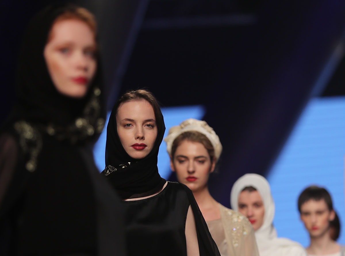 Models walk down the catwalk wearing designs by Zoe Eckett during the Arab Fashion Week in the United Arab Emirate of Dubai on May 18, 2017.