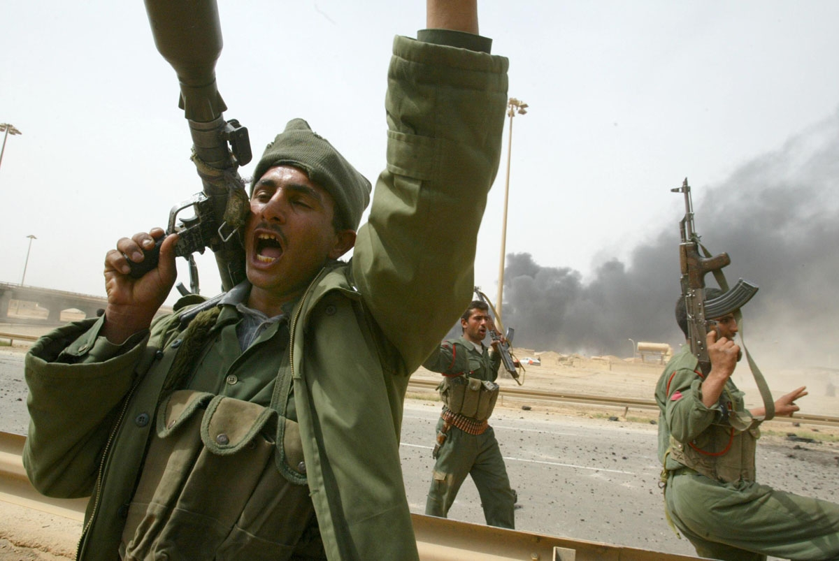 Iraqi Republican Guards shout anti-US slogans as they head to the front south of Baghdad 06 April 2003. US forces closed in on Baghdad from opposite directions, US officials said, as coalition forces prepared to launch a final assault on the battered capi