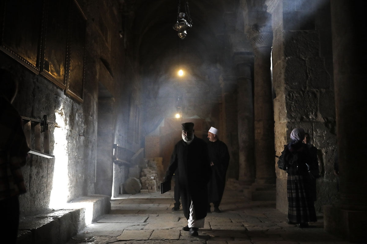 An Ethiopian priest walks inside the Holy Sepulchre church, one of the holiest place for Christians, in the Old City of Jerusalem, on February 9, 2018.