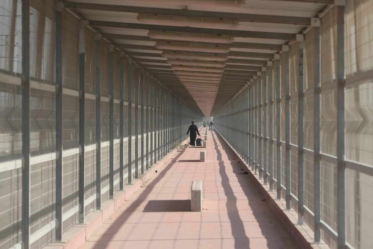 A Palestinian priest from the Gaza Strip walks through the Erez crossing towards Israel, December 22, 2011.