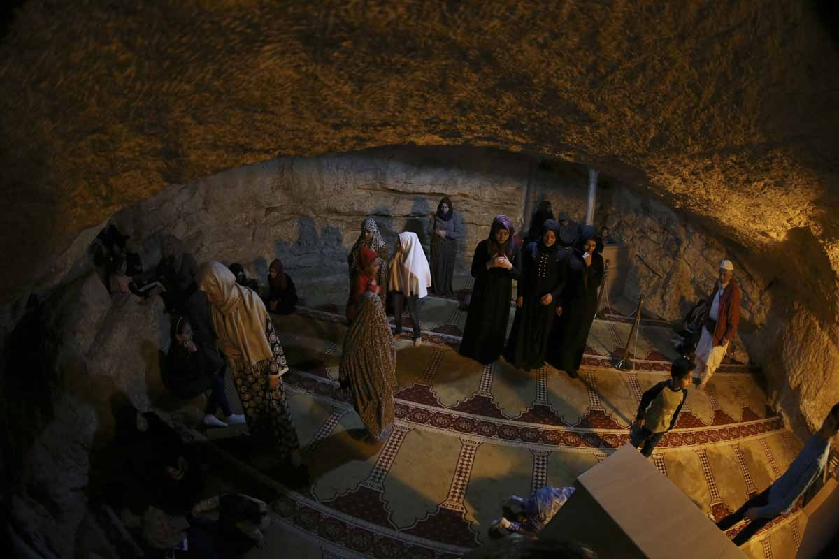 Women pray in the shrine under the Dome of the Rock at the Al-Aqsa compound in Jerusalem's Old City, April, 2017.