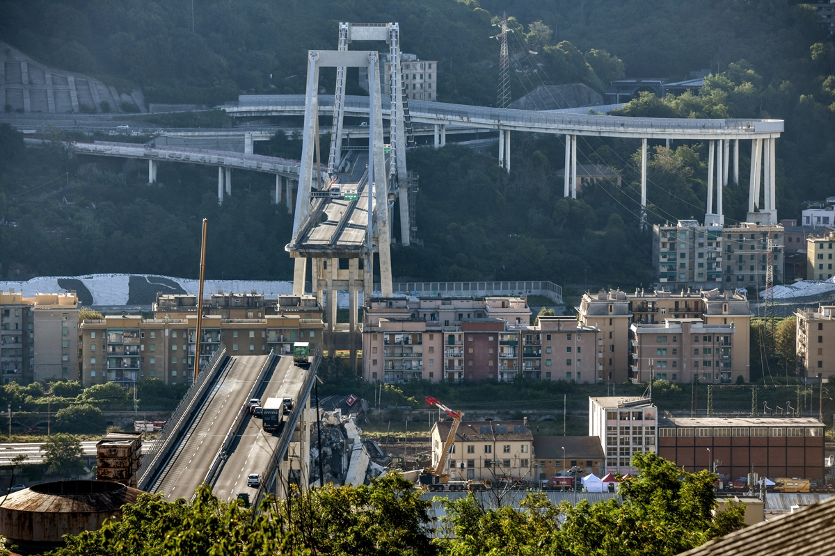 This general view taken on August 15, 2018, shows abandoned vehicles on the Morandi motorway bridge after a section collapsed in the north-western Italian city of Genoa.