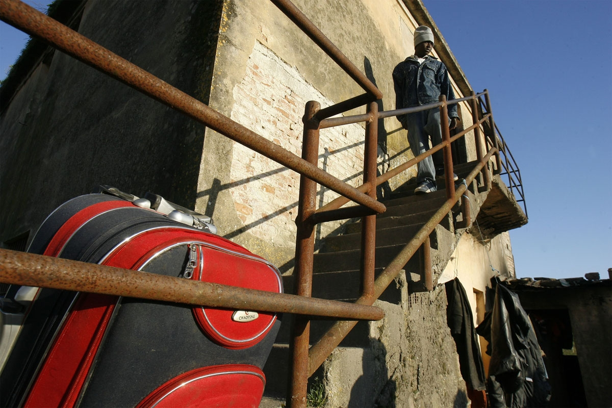 An Immigrant worker prepare to be evacuated from a house where he was living with other migrants in the southern town of Rosarno, on January 9, 2010. Italian authorities sent in extra police and evacuated migrants Saturday from a southern Italian town aft