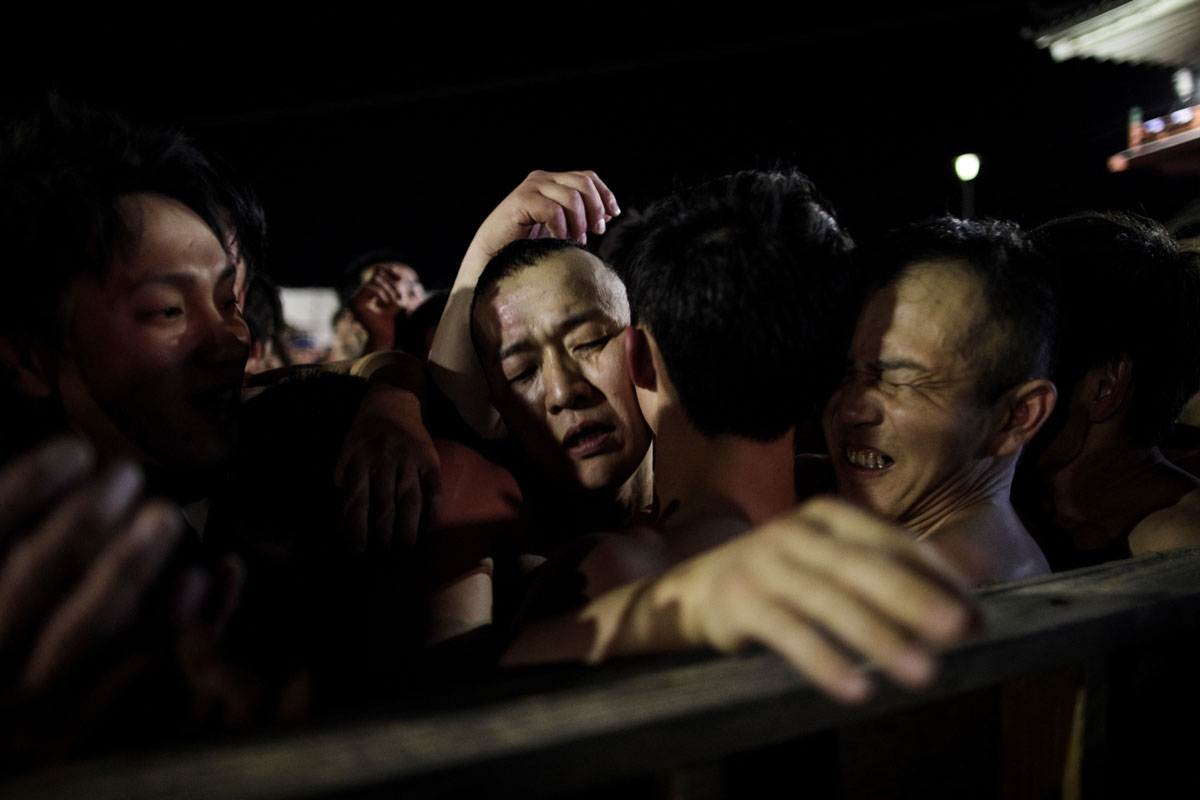 In this picture taken on February 18, 2017, worshippers scuffle to catch the thrown sacred batons during the annual Naked Man Festival or 'Hadaka Matsuri' at Saidaiji Temple in Okayama, western Japan.