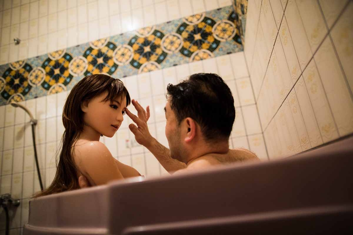 In this picture taken late on June 13, 2017, physiotherapist Masayuki Ozaki takes a bath with his silicone sex doll Mayu at a love hotel in Yachimata, Chiba prefecture.