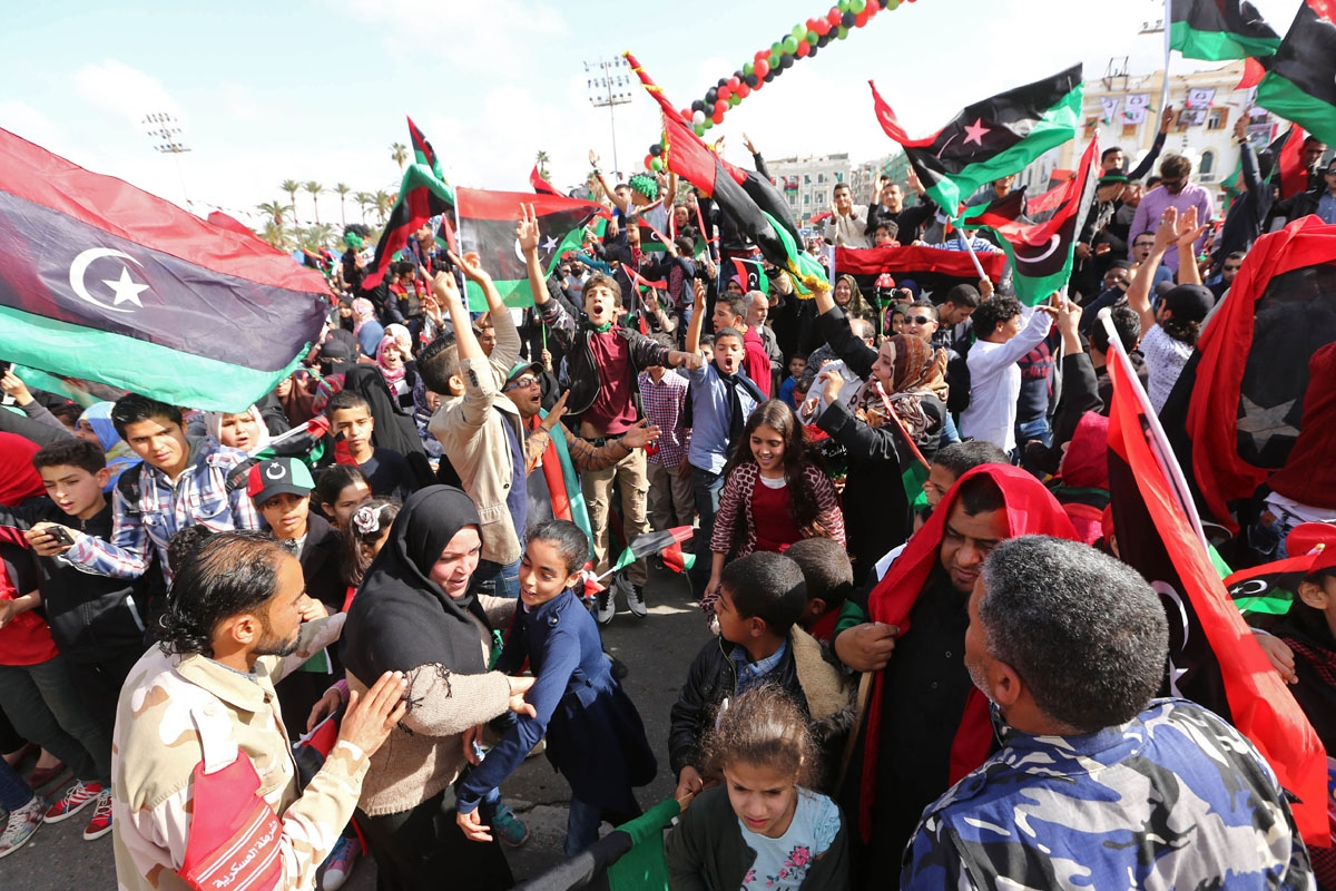 Libyans take part in celebrations marking the fifth anniversary of the Libyan revolution, which toppled strongman Moamer Kadhafi, at Martyrs' Square in the capital Tripoli, on February 17, 2016.