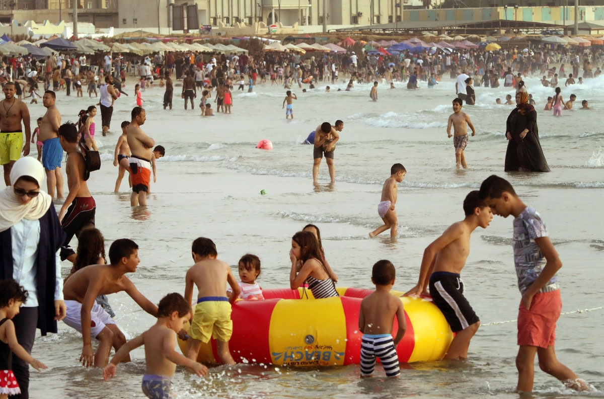 Libyans hang out at the beach in the capital Tripoli on July 14, 2016.