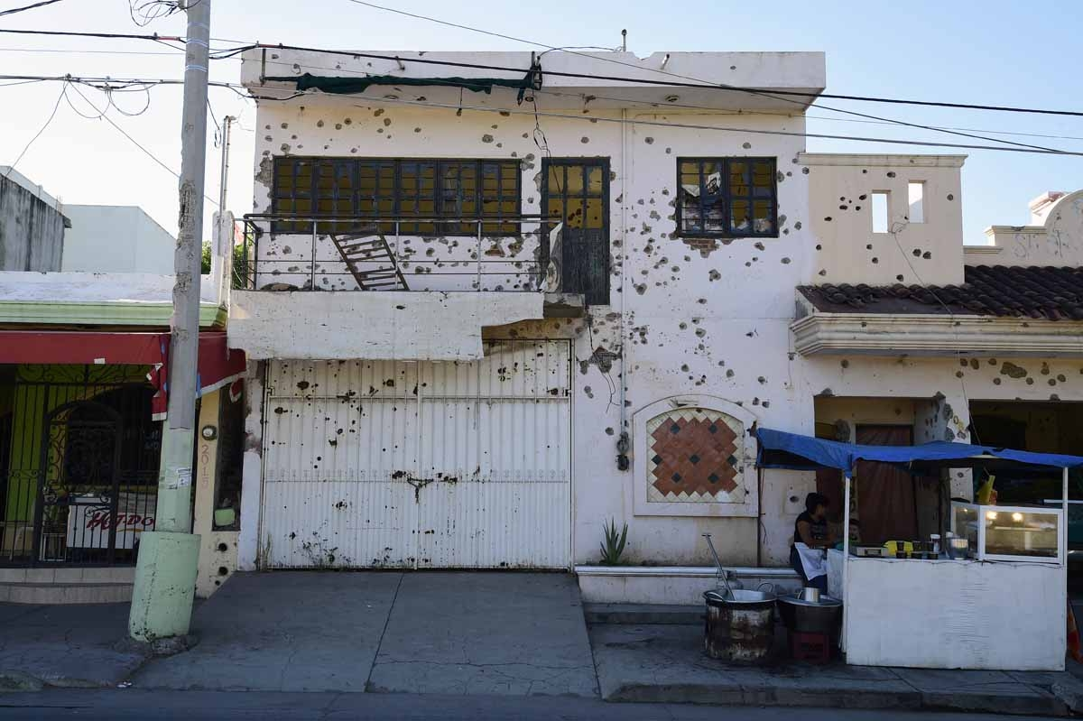 View of a house with hundreds of bullet holes in Cualican, Sinaloa state, Mexico, on December 7, 2016.