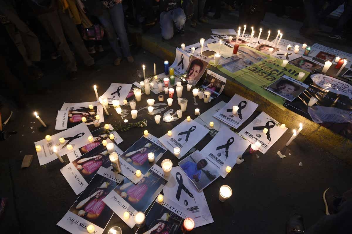 Candles and portraits of slain Mexican journalists are seen during a protest demanding the Mexican government catch the killers of Javier Valdez, the fifth and most high-profile journalist murdered this year in the country's drug-trafficking ganglands, in