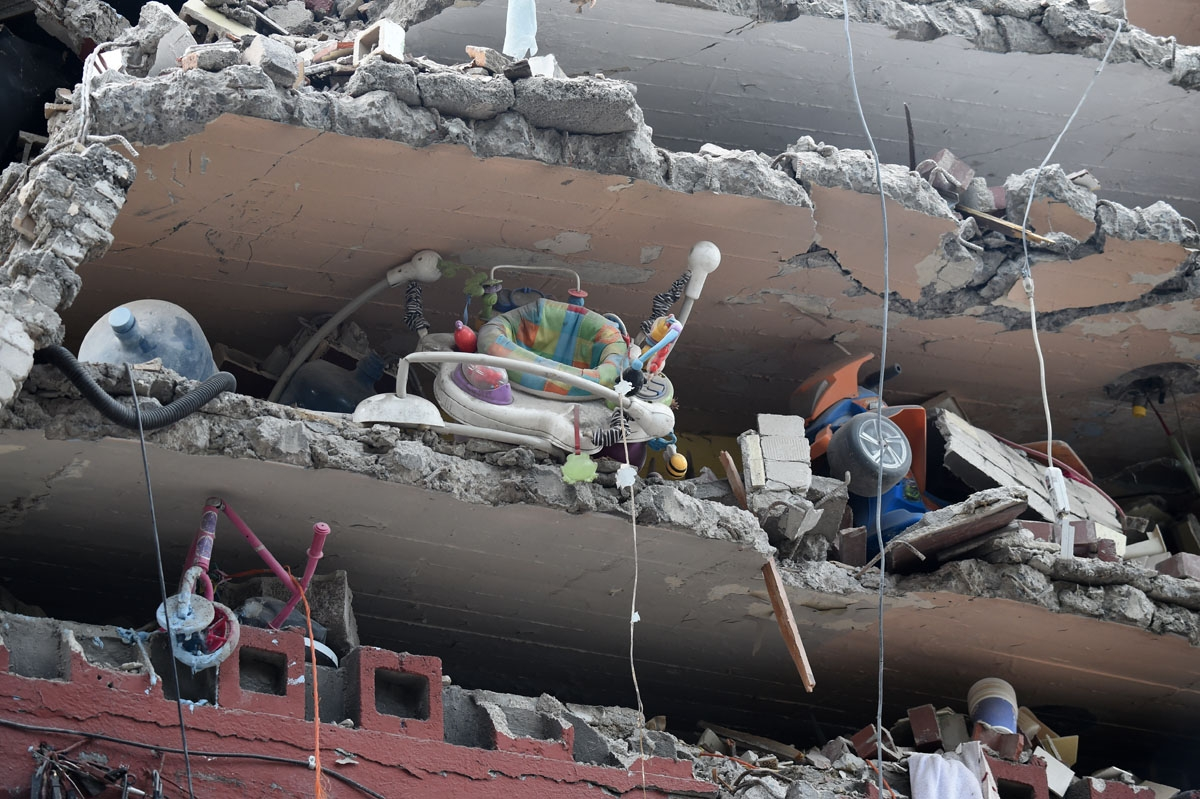 Toys and a baby walker are seen in a building flattened by the strong quake that hit central Mexico on the eve, taken on September 20, 2017 as the searches for survivors continues.