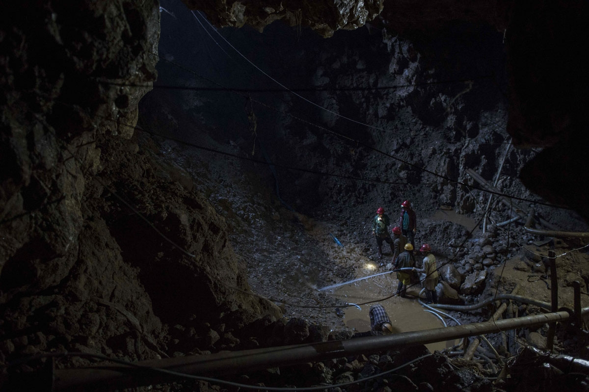 This photo taken on November 24, 2016 shows miners working inside a ruby mine in Mogok, north of Mandalay.