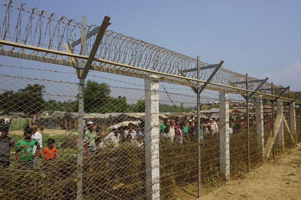 Minority Rohingya Muslims gather behind Myanmar's border lined with barbed wire fences in Maungdaw district, located in Rakhine State bounded by Bangladesh on March 18, 2018.