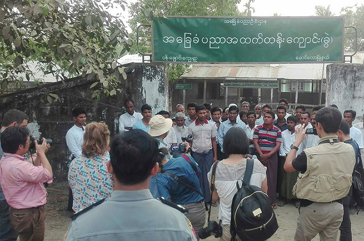 This handout photo taken on March 17, 2018, and released by Myanmar News Agency on April 3, 2018, shows a group of foreign journalists interviewing Muslim Rohingya residents during a government controlled trip in Maungdaw, near the Myanmar-Bangladesh bord