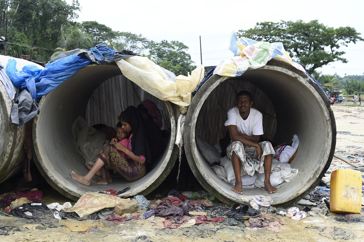 Rohingya Muslim refugees shelter in cement pipes at Kutupalong refugee camp in the Bangladeshi district of Ukhia on September 20, 2017.