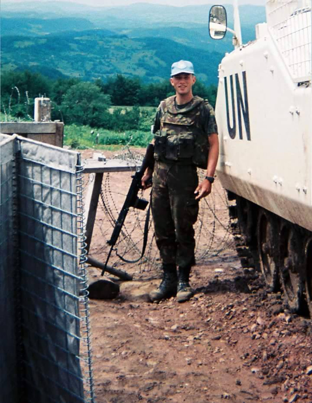 This handout picture taken on April 1995 and released in July 9, 2015 shows peacekeeper Edo van den Berg from Netherlands posing at the Charlie chekpoint in Srebrenica.