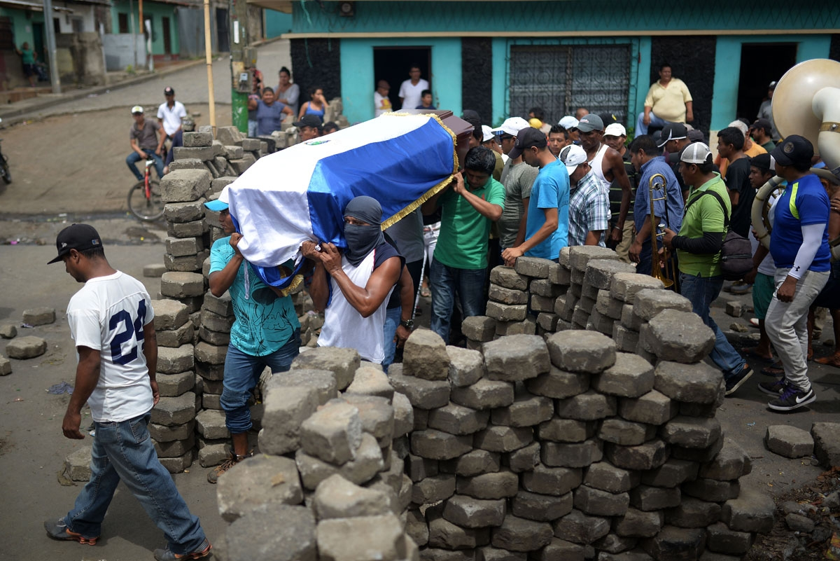 Friends and relatives carry the coffin of Jose Esteban Sevilla Medina, who was shot dead during clashes with riot police and paramilitaries at Monimbo neighbourhood in Masaya, some 35 km from Managua, on July 16, 2018