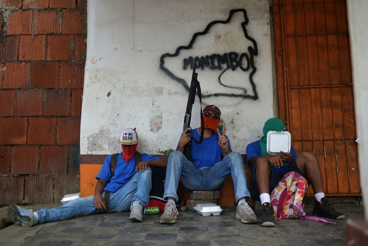 "Paramilitaries rest in Monimbo neighborhood in Masaya, Nicaragua, on July 18, 2018, following clashes with anti-government demonstrators. The head of the Inter-American Commission on Human Rights has described as ""alarming"" the ongoing violence in Nicarag"