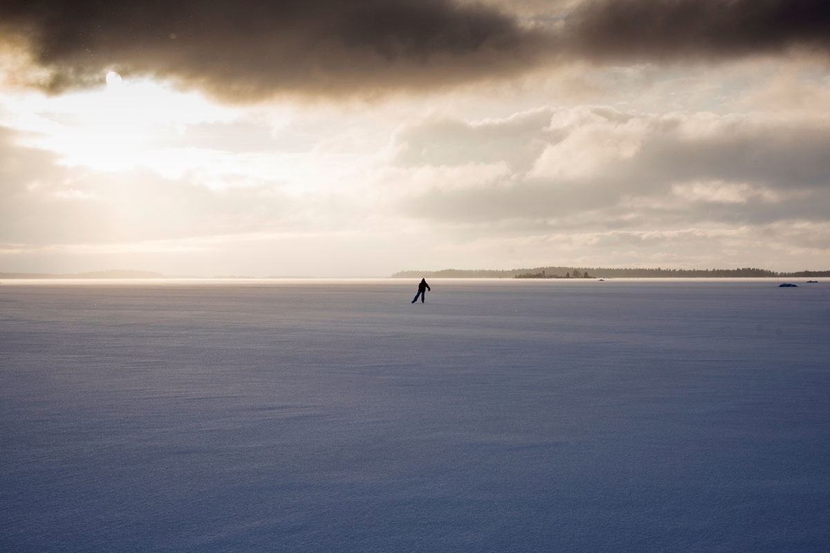 A woman skates on the frozen Bothnia sea (Baltic Sea), on January 30, 2018, in Vaasa, northern Norway, Lofoten islands, within the Arctic Circle. /