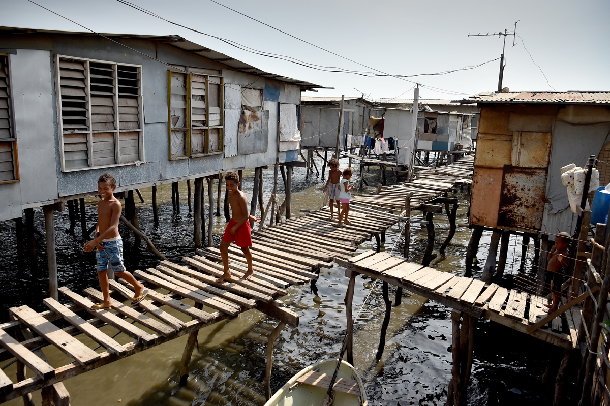 Residents are seen in the village of Hanuabada, one of only two remaining stilt villages in Port Moresby on November 15, 2018 ahead of the Asia-Pacific Economic Cooperation (APEC) summit.