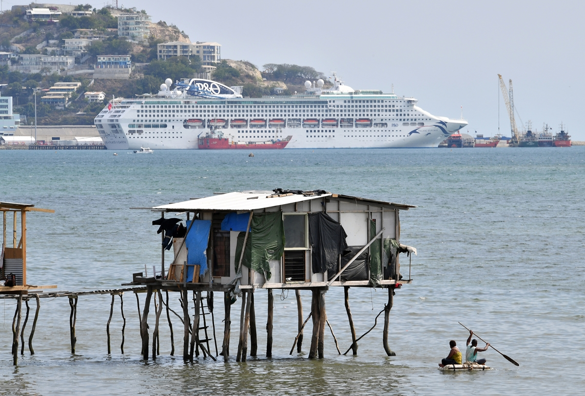 This picture taken on November 19, 2018 show makeshift huts seen across the ship accommodating delegates and journalists attending the Asia-Pacific Economic Cooperation (APEC) Summit in Port Moresby.