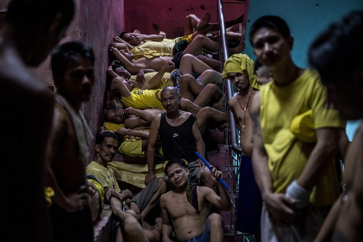 Inmates sleep on a staircase at the Quezon City jail on July 18, 2016