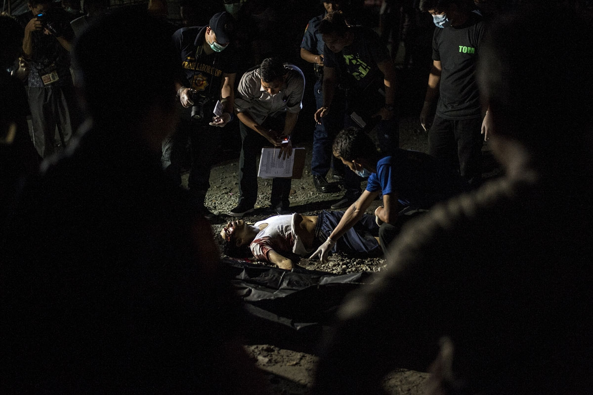 The body of an alleged drug pusher lies in a street of Manila on July 27, 2016