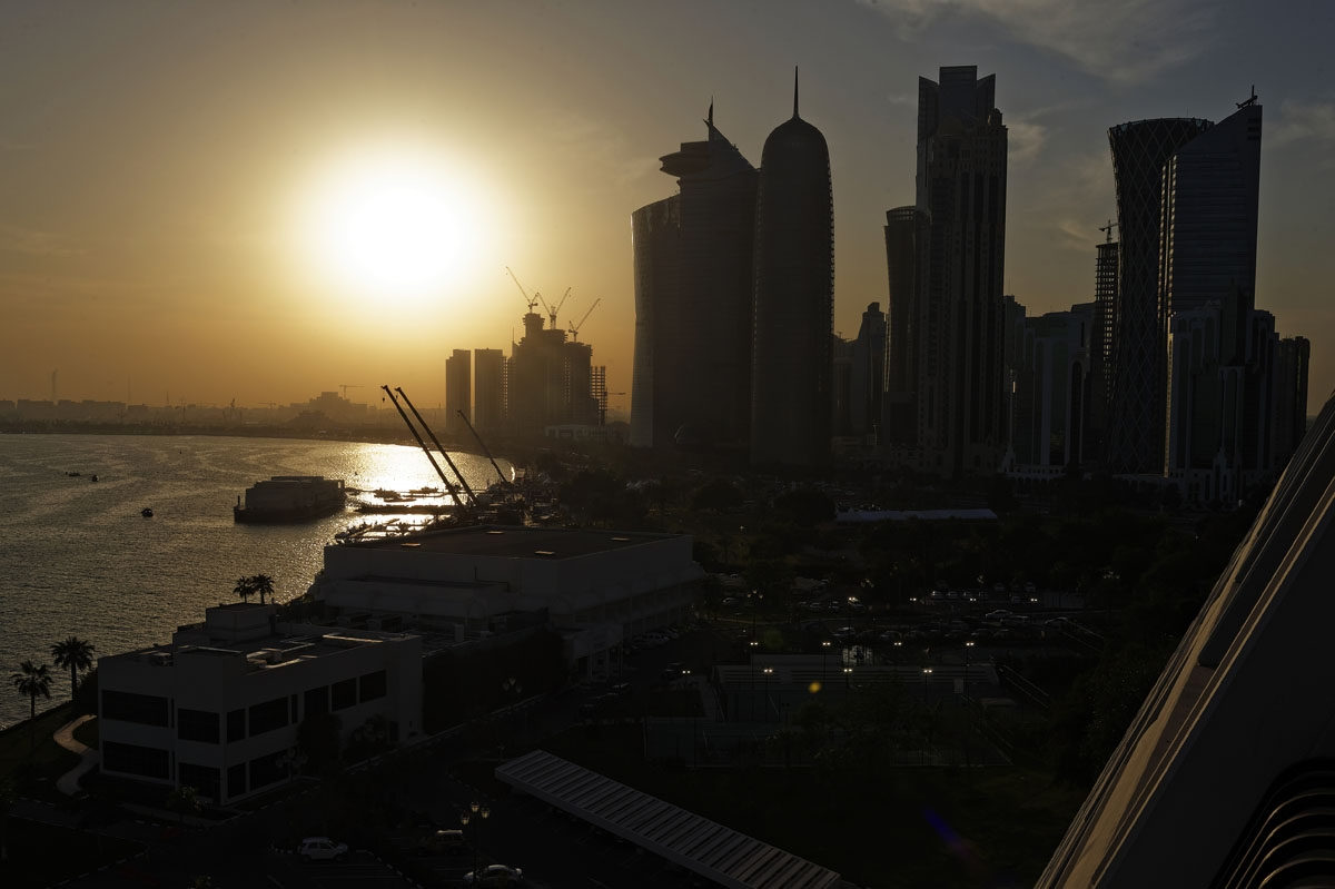 The sun sets over the Qatari capital Doha on February 7, 2015.