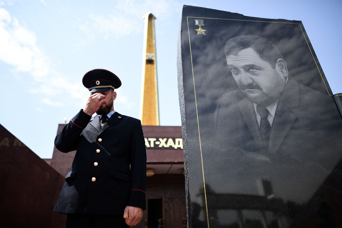 A Chechen police officer gestures as he stands guard in front of the memorial for Akhmad Kadyrov, the father of current Chechen President Ramzan Kadyrov, in Grozny on July 25, 2017.