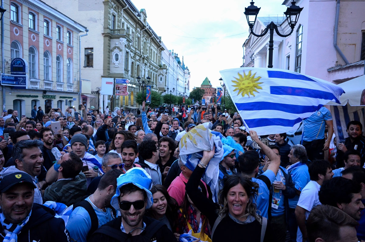 Uruguay fans cheer in central Nizhny Novgorod on July 5, 2018, on the eve of the Russia 2018 World Cup quarter final football match between France and Uruguay.