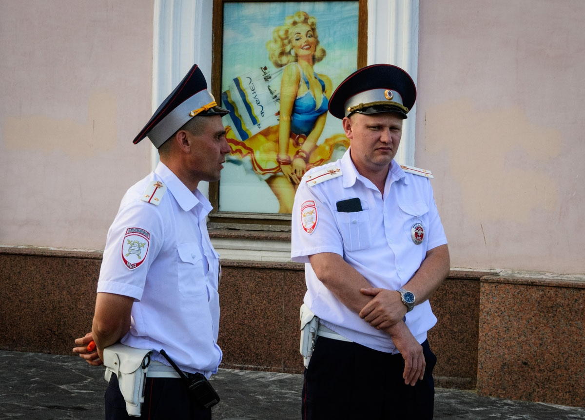 Two policemen guard on a street in the center of Nizhny Novgorod on July 4, 2018.