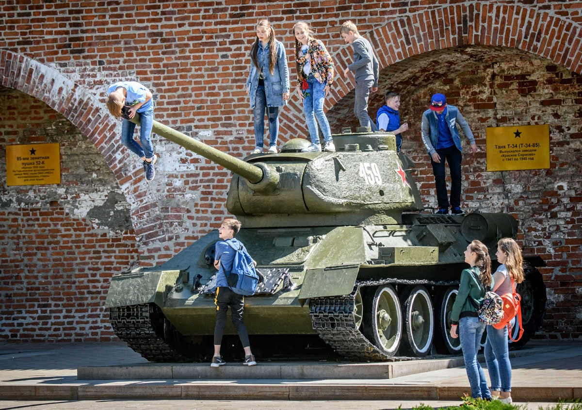 Children play atop a Soviet T-34 tank at a local military museum in Nizhny Novgorod on May 21, 2018.
