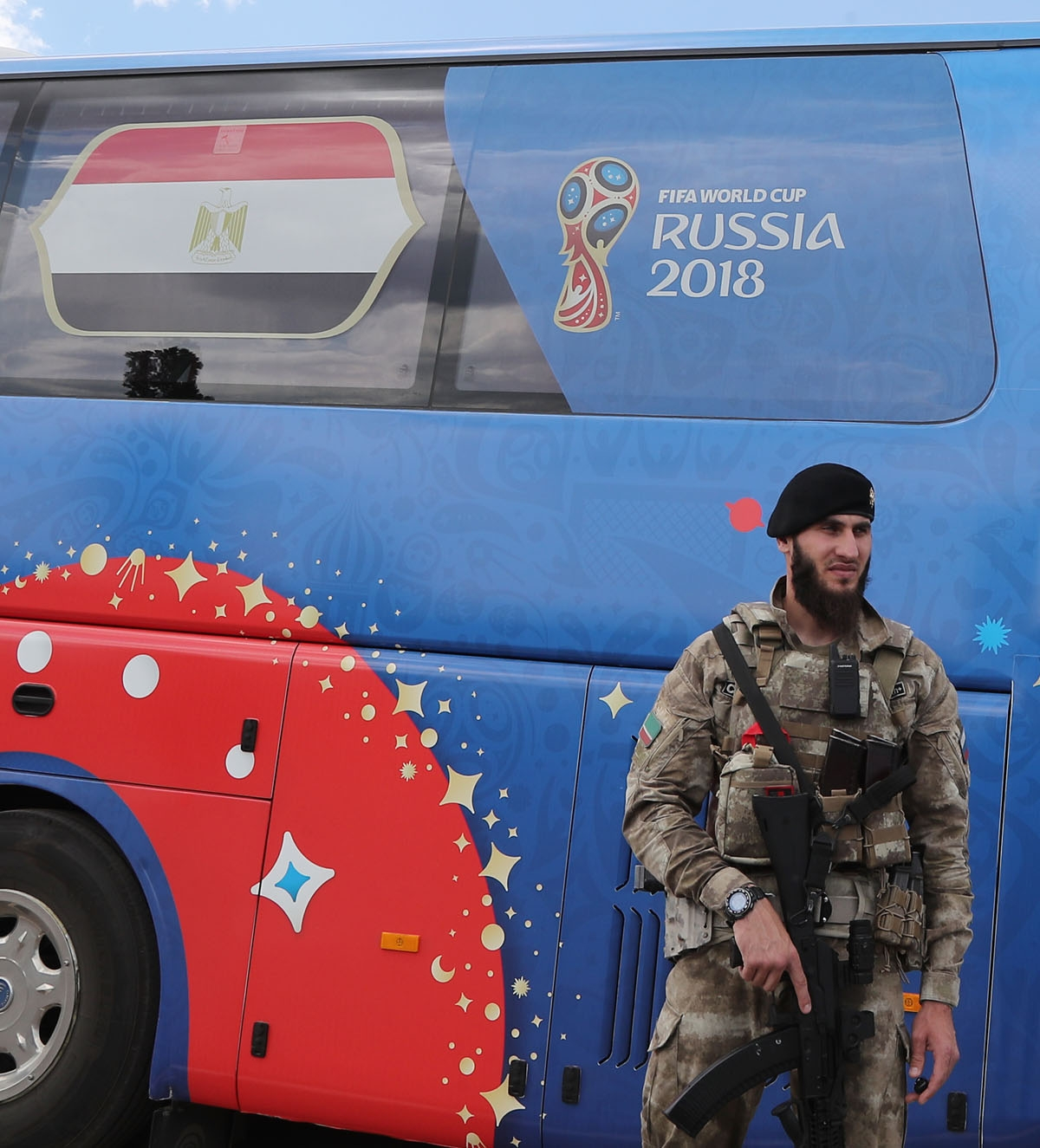 A soldier patrols around the Egyptian team bus at Grozny International Airport on June 10, 2018, ahead of the Russia 2018 World Cup. / AFP PHOT
