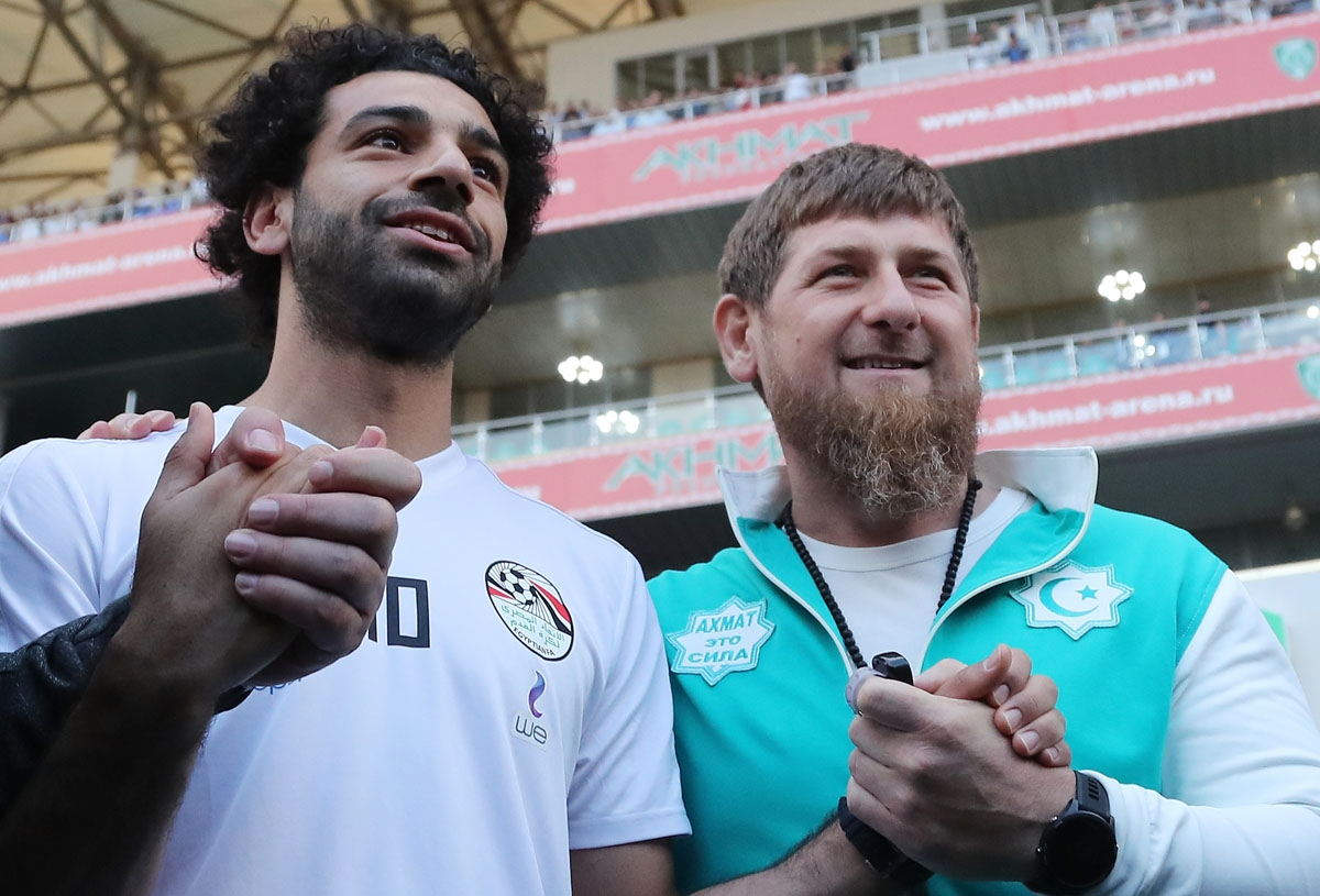 Egyptian national football team player and Liverpool's star striker Mohamed Salah (L) poses with head of the Chechen Republic Ramzan Kadyrov during a training at the Akhmat Arena stadium in Grozny on June 10, 2018, ahead of the Russia 2018 World Cup.
