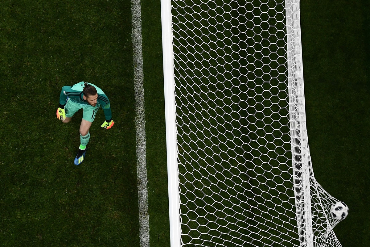 Spain's goalkeeper David De Gea concedes the third goal during the Russia 2018 World Cup Group B football match between Portugal and Spain at the Fisht Stadium in Sochi on June 15, 2018. / AFP PHOTO / Jewel SAMAD /