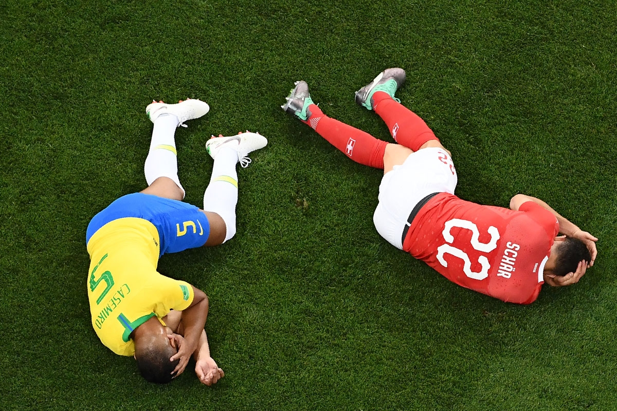 Brazil's midfielder Casemiro (L) and Switzerland's defender Fabian Schaer react after a shock during the Russia 2018 World Cup Group E football match between Brazil and Switzerland at the Rostov Arena in Rostov-On-Don on June 17, 2018. / AFP PHOTO
