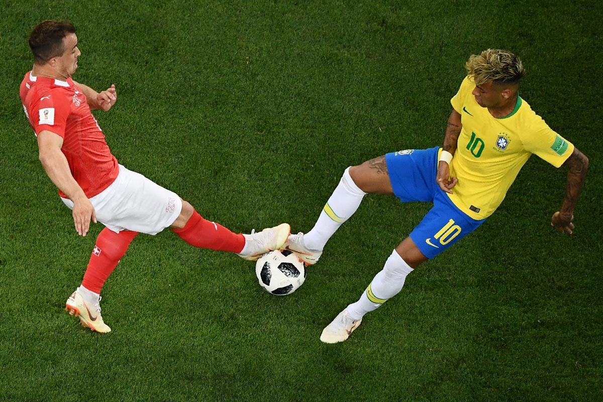 Brazil's forward Neymar (L) vies with Switzerland's forward Xherdan Shaqiri during the Russia 2018 World Cup Group E football match between Brazil and Switzerland at the Rostov Arena in Rostov-On-Don on June 17, 2018. / A