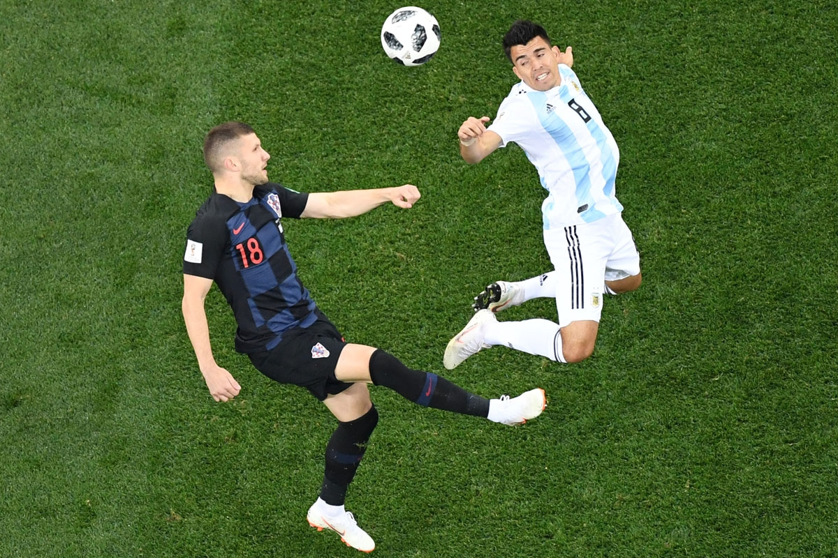 Croatia's forward Ante Rebic (L) vies Argentina's defender Marcos Acuna during the Russia 2018 World Cup Group D football match between Argentina and Croatia at the Nizhny Novgorod Stadium in Nizhny Novgorod on June 21, 2018.