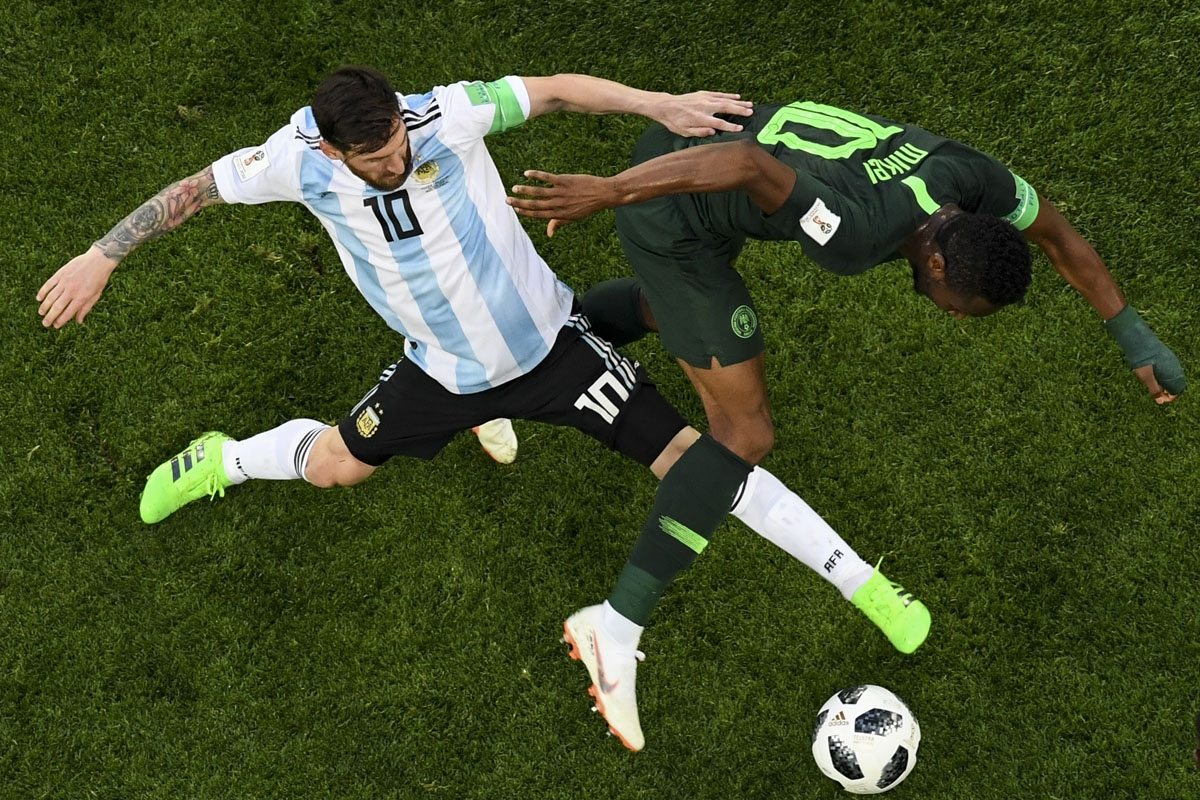 Argentina's forward Lionel Messi (L) and Nigeria's midfielder John Obi Mikel compete for the ball during the Russia 2018 World Cup Group D football match between Nigeria and Argentina at the Saint Petersburg Stadium in Saint Petersburg on June 26, 2018.