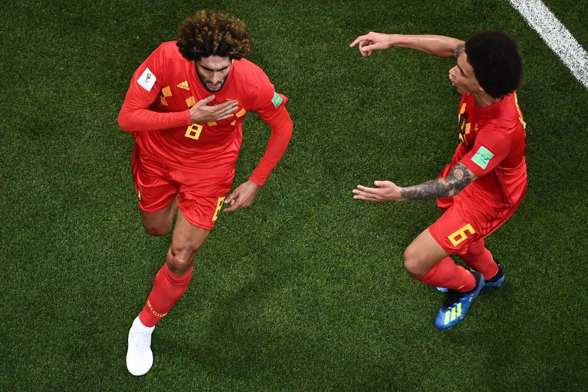Belgium's midfielder Marouane Fellaini (L) celebrates with Belgium's midfielder Axel Witsel after scoring his team's second goal during the Russia 2018 World Cup round of 16 football match between Belgium and Japan at the Rostov Arena in Rostov-On-Don on