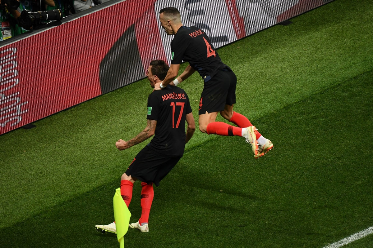 Croatia's forward Mario Mandzukic (L) celebrates with Croatia's forward Ivan Perisic after scoring his team's second goal during the Russia 2018 World Cup semi-final football match between Croatia and England at the Luzhniki Stadium in Moscow on July 11